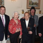 Celebrating 70 years with the fire company, Bill House (center) is joined from left to right by Chief Wilmot, his wife Audrey, Son Steve House, and President Dean Seltzer.