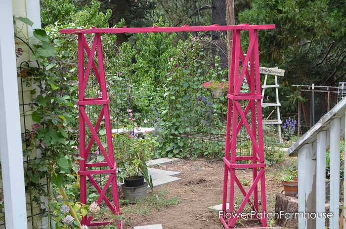 Build yourself this fabulous arbor from 2 obelisks and diy ladder. Great weekend project that adds that special touch to your garden!
