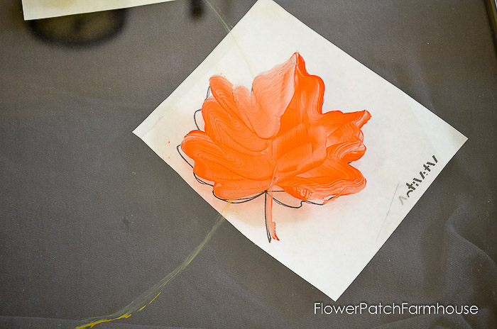 underpainting of fall leaf on glass windwo