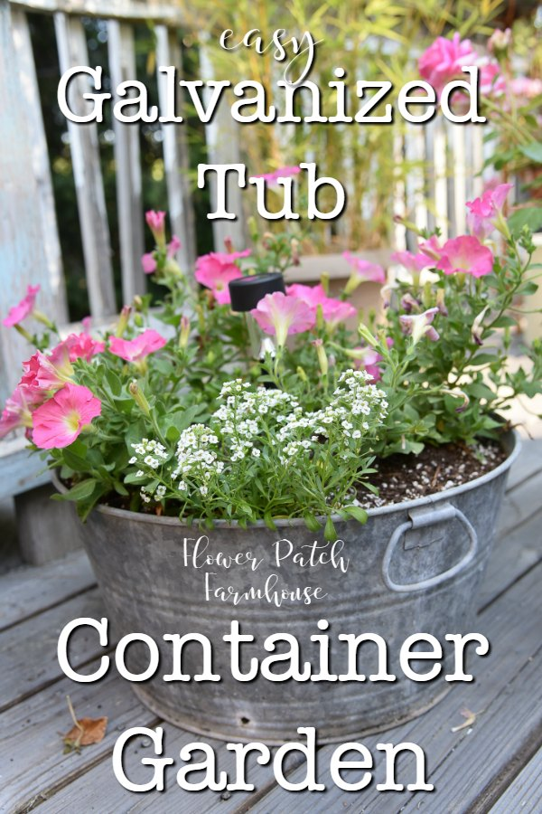 pink petunias and white alyssum in a galvanized tub planter with text overlay, Galvanized Tub Container Garden, Flower Patch Farmhouse
