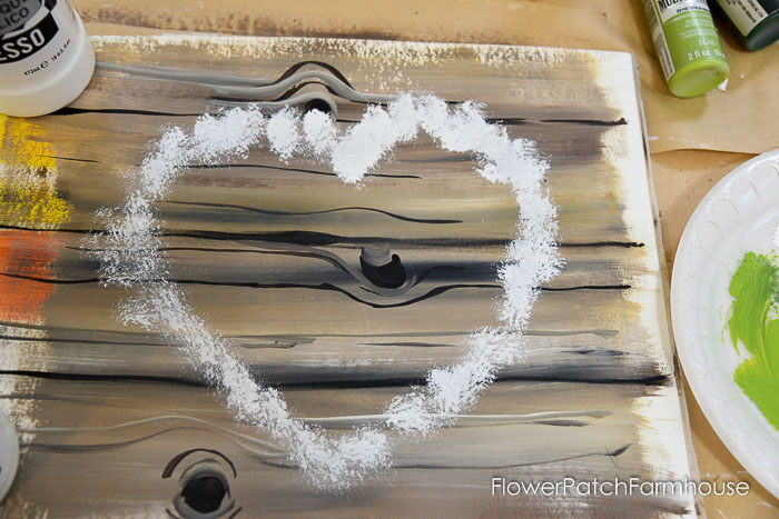 white paint tapped in heart shape