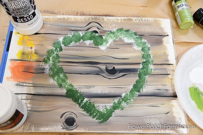 Dark green painted over white on heart wreath