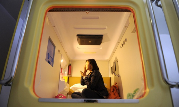 "Mandatory Credit: Photo by HAP/Quirky China News / Rex Features (1989248d) A person in their 'room' at the capsule hotel Capsule hotel in Chongqing, China - 24 Nov 2012 Southwest China's first capsule hotel recently opened in Guanyinqiao, Chongqing municipality.  The ""capsule"" hotel features 16 rooms, with each measuring 1.2 meters wide and 2.2 meters long. Each room comes equipped with power supply, clock, wall lamp, TV, air conditioner and WIFI. An overnight stay costs 38 Yuan (GBP 3.80)."