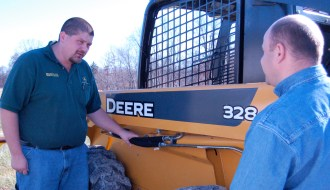 salesman selling skid steer