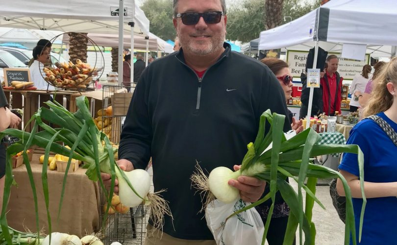 Floyd Jerkins with Onions at Farmers Market