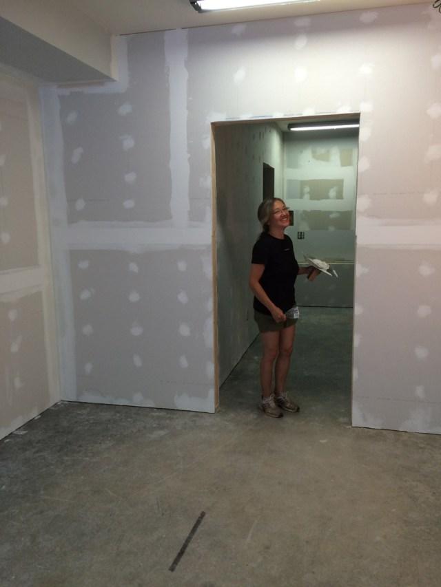 Katy on the case, skimming drywall for Stefan Morikawa, LLC.