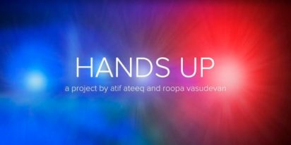 """Blue and red lights from a police car are in the background and the words """"HANDS UP"""" is in the center of the image. Below are the words """"a project by atif ateeq and roopa vasudevan""""."""