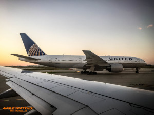 United 777 taxiing back prior to pushback