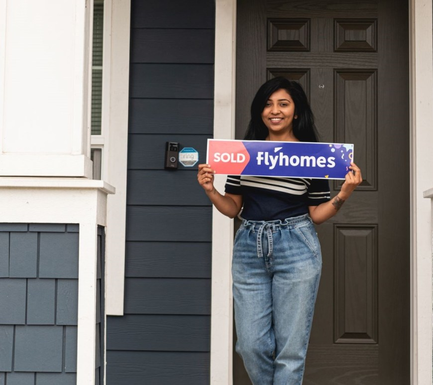 Flyhomes client with sold sign