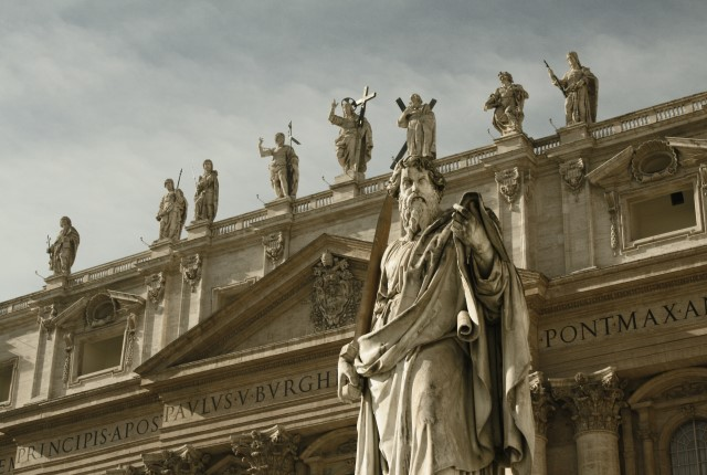 Statues close to heaven on top of St. Peter's Basilica's façade at Vatican City
