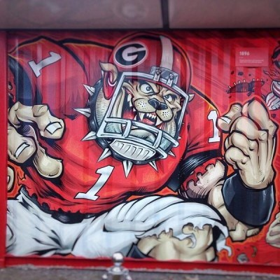 Here's a shot of my Georgia Bulldog illustration being wrapped on the Chick-Fil-A restaurant on the Georgia-Florida state line for their nationally televised commercial - so lucky to be a part of this! #georgiabulldogs #georgiafootball #mascotdesign #chickfila