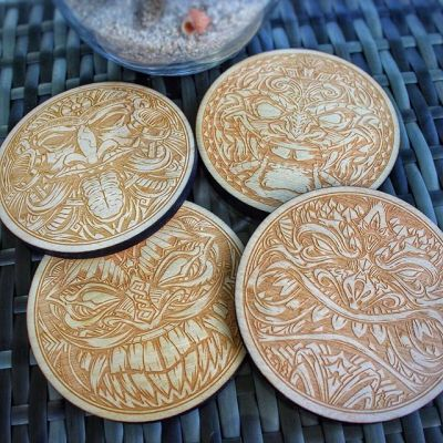 "So happy to release my first set of coasters! Intricite hand-drawn tiki artwork laser-engraved with a real space-laser in wood - 1/4"" thick, 4"" wide. Now available in my shop! https://www.flylanddesigns.com/shop/#coaster #tikiart #tikibar #beachart #tikitotem #surfart #tikiartist #beach #laserengraving"