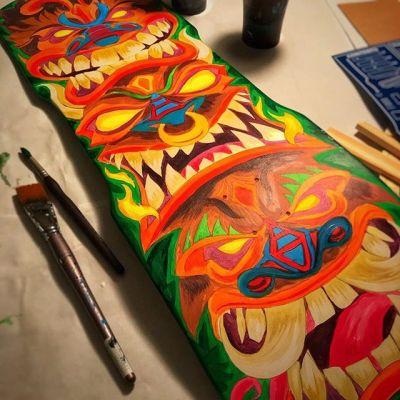 Pretty much finished with the colors - ready to start inking the lines. Acrylic paint on beautiful a custom shaped skate deck.#skateboardart #deckart #skaterart #deckdesign #skateboarding#tikiart #tikibar #beachart #tikitotem #surfart #tikiartist #beach