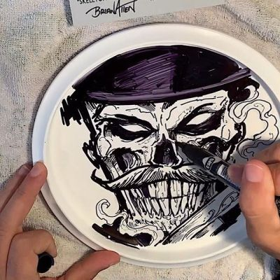 Drew an original sharpie ink drawing on the back of one of my metallic foil Skeleton Gunslinger disc golf discs at the request of a really cool customer. They wanted a nod to Doc Holiday so I slapped a big mustache on him. Tricky to draw on this slippery plastic surface! Learned the hard way to put a towel underneath while I'm drawing, otherwise the foil side will scratch!#skull #skeleton #discgolf #discgolfdisc #discraft #sharpie #sharpiedrawing