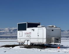 Picture of the mobile air traffic control tower with a Rocky Mountain backdrop
