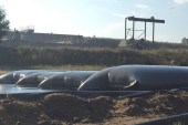 Fibertex geotextile dewatering bags for desludging wastewater ponds