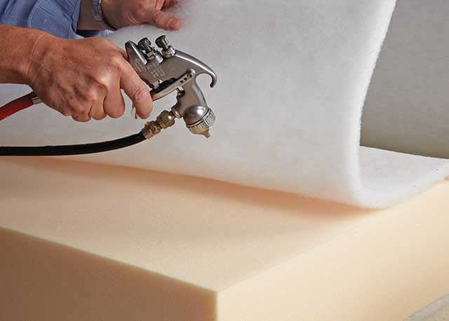 Polyester Fibre Wrap being fitted to the foam seat cushion to achieve the plump cushion look.