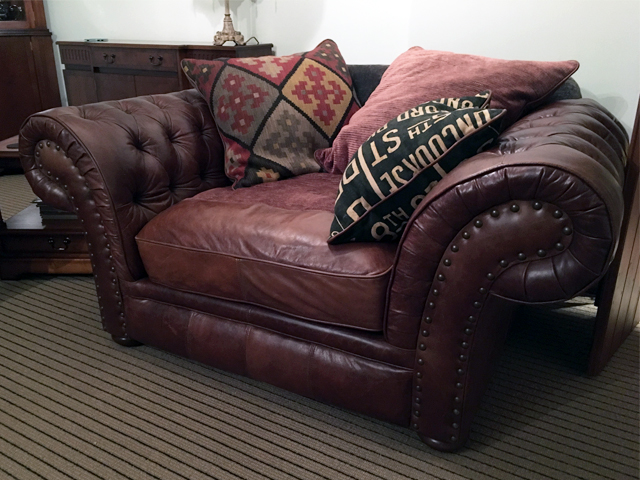 Image of a Leather Snuggle Seat needing leather cushion replacement.