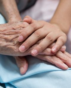 Young girl's hand touches and holds an old woman's wrinkled hands.; Shutterstock ID 115740043; PO: 47953; Other: Public Affairs