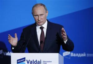 Russian President Vladimir Putin speaks during a meeting with 'Valdai' International Discussion Club members in town of Valdai