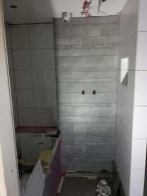 Betegelen nieuwe badkamer