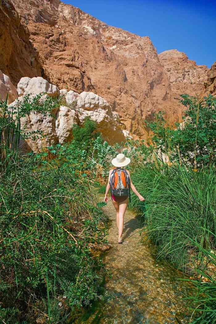 Hiking between pools in Wadi Shab
