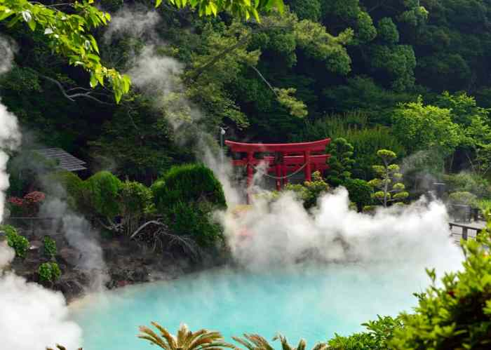 hot spring in Japan with red gate and steam