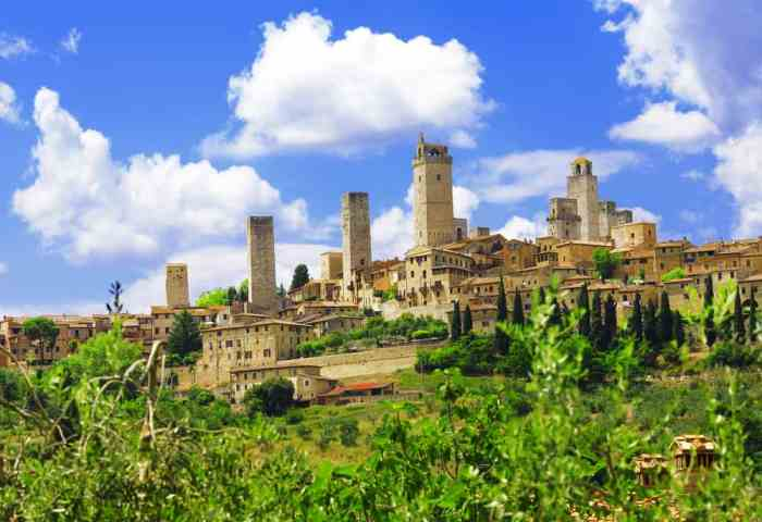 San Gimignano sits in the hills of Tuscany, a beautiful sight with its towers jutting into the blue sky.