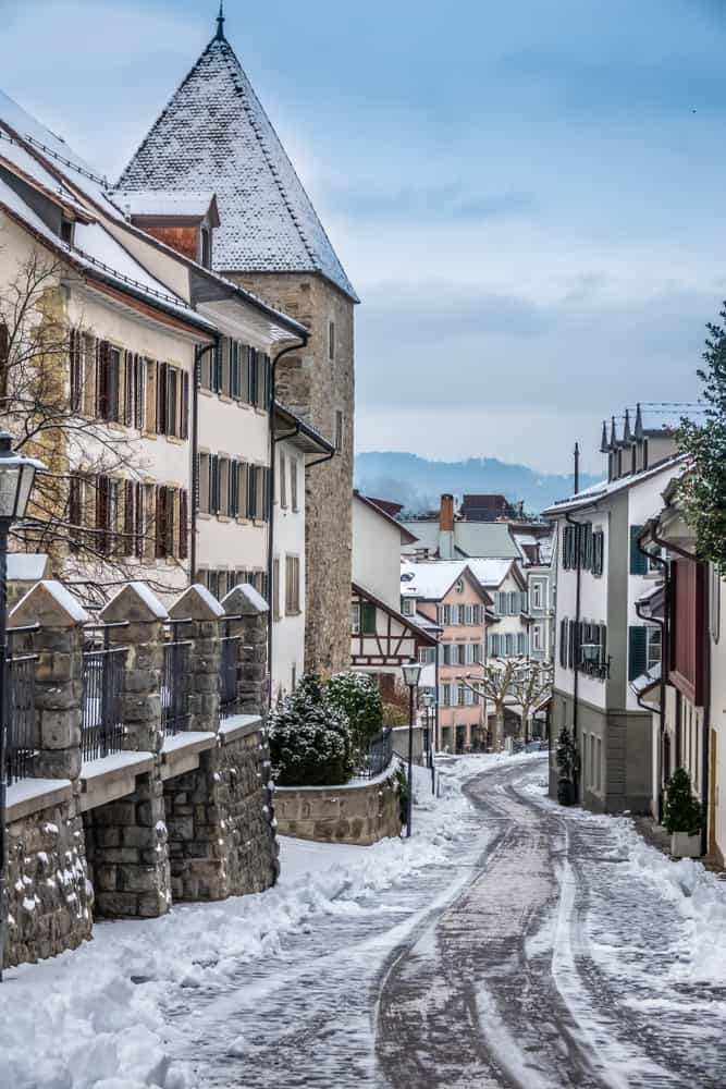 Enjoy the snow as you walk through the streets of the Rapperswil Christmas market