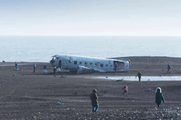 tourists walking around the Iceland plane crash