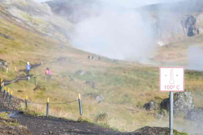 signs indicate water too hot to touch along Reykjadalur Hot Springs hike