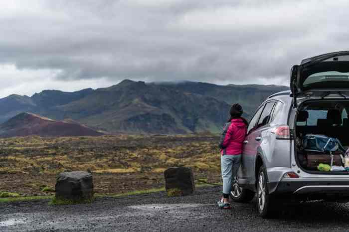 woman outside after she was renting a car in Iceland