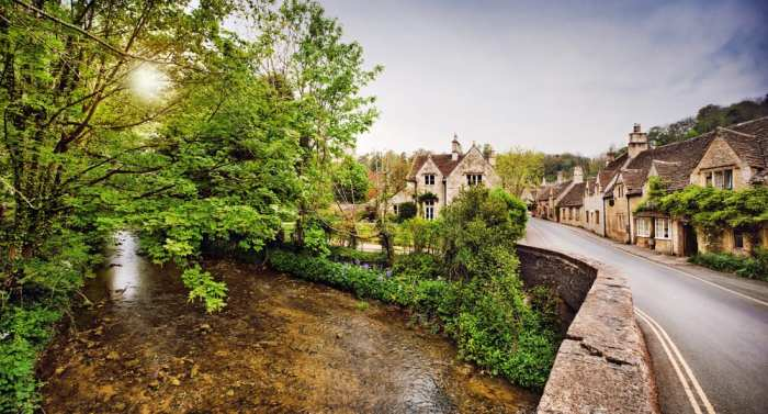 This is the entrance of Castle Combe village: its winding road and calming, flowing river are picturesque.