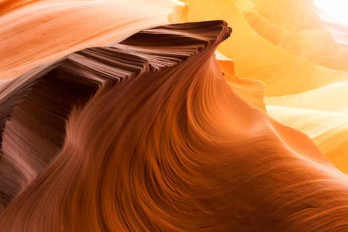 a curvy rock formation in Lower Antelope Canyon