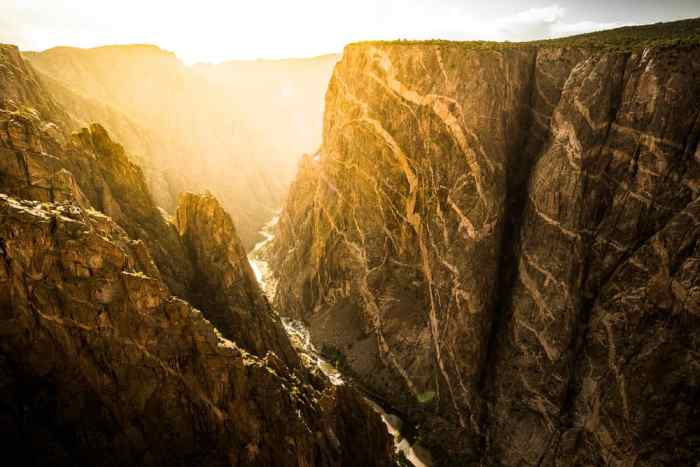 hike into the canyon at Black Canyon of the Gunnison National Park on your Colorado road trip