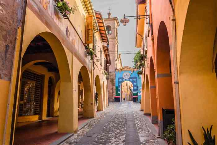 small town in italy with painted yellow walls