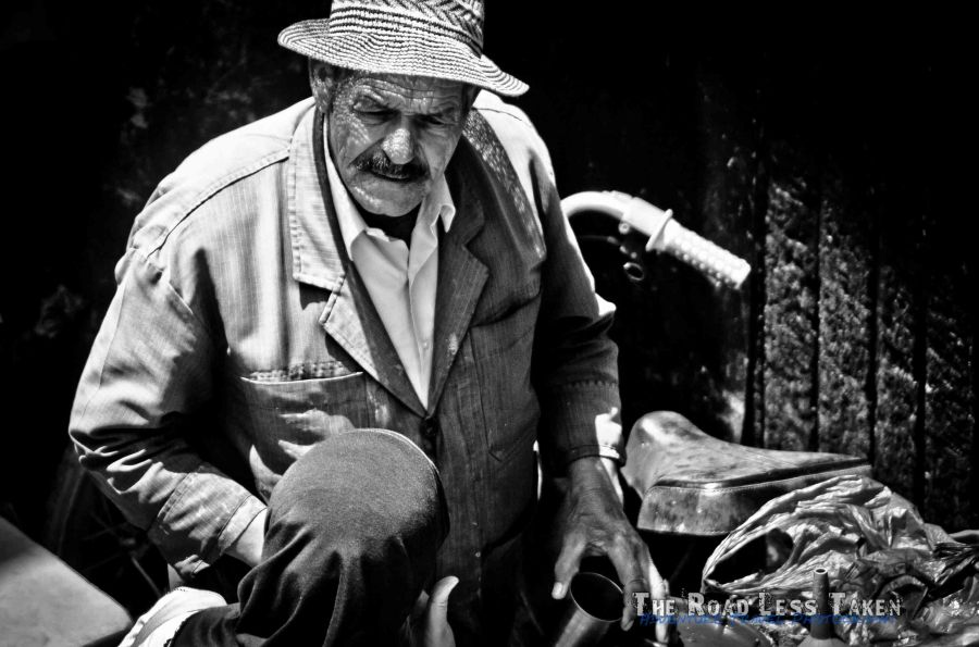 Moroccan street vendor in black and white