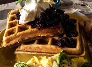 Waffles with whipped cream and traditionally fermented Korean black raspberries.