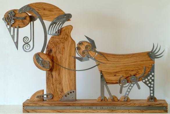 Fig. 5 – La vecchia e la capra (ulivo e acciaio cm 130)
