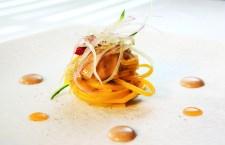 Spaghetti di farina di lenticchie e ricci di mare, Il Pagliaccio
