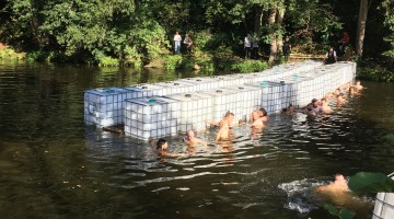 Building bridges: GELINAZ! gang jump into river to create floating bridge