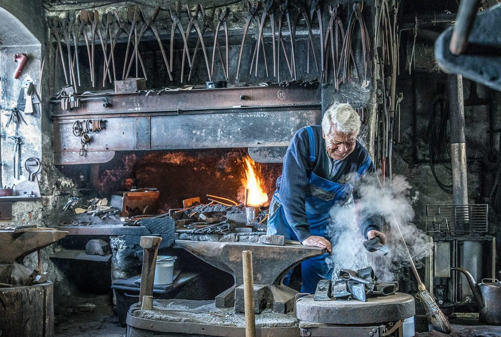 The Hachl-blacksmith, Josef Geisler, in his forge