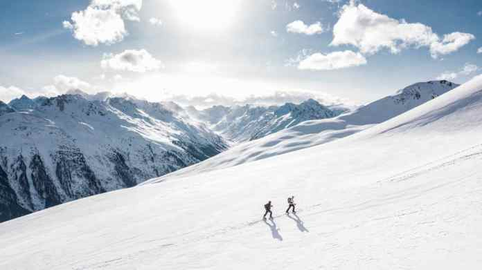 Snowshoeing up a mountainside