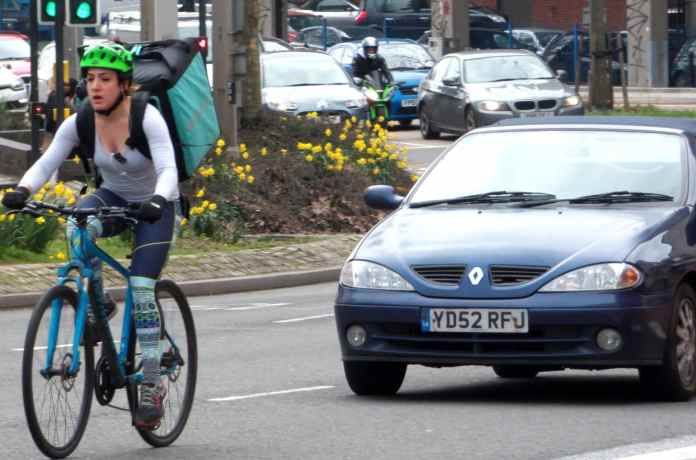 Deliveroo Rider Taking The Lane In Bristol 32611782273 cropped cropped
