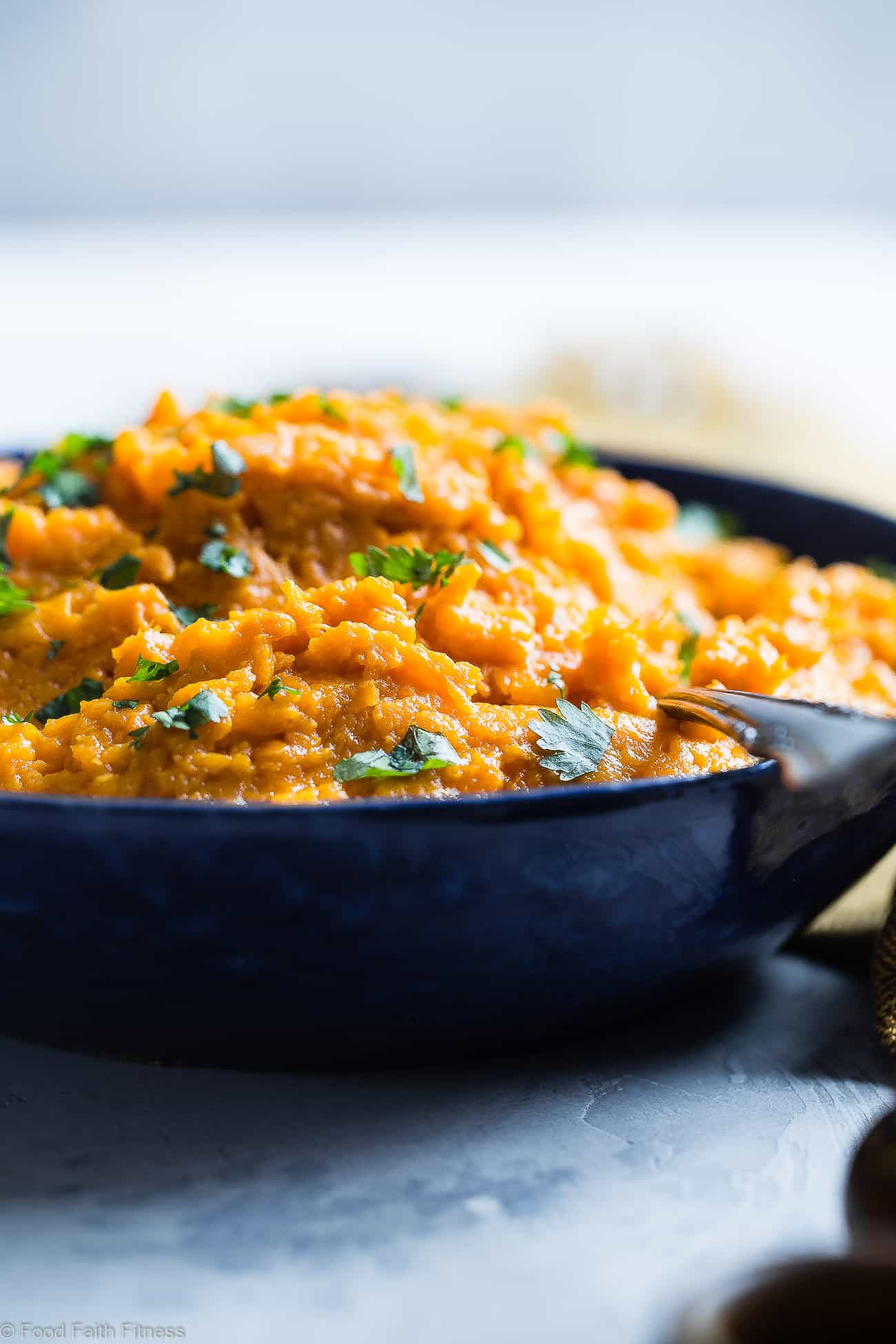 Coconut Curry Mashed Sweet Potatoes - Asweet and spicy spin on a holiday classic! So creamy you will never believe they are dairy, grain and gluten free and paleo/vegan/whole30 compliant! | Foodfaithfitness.com | @FoodFaithFit