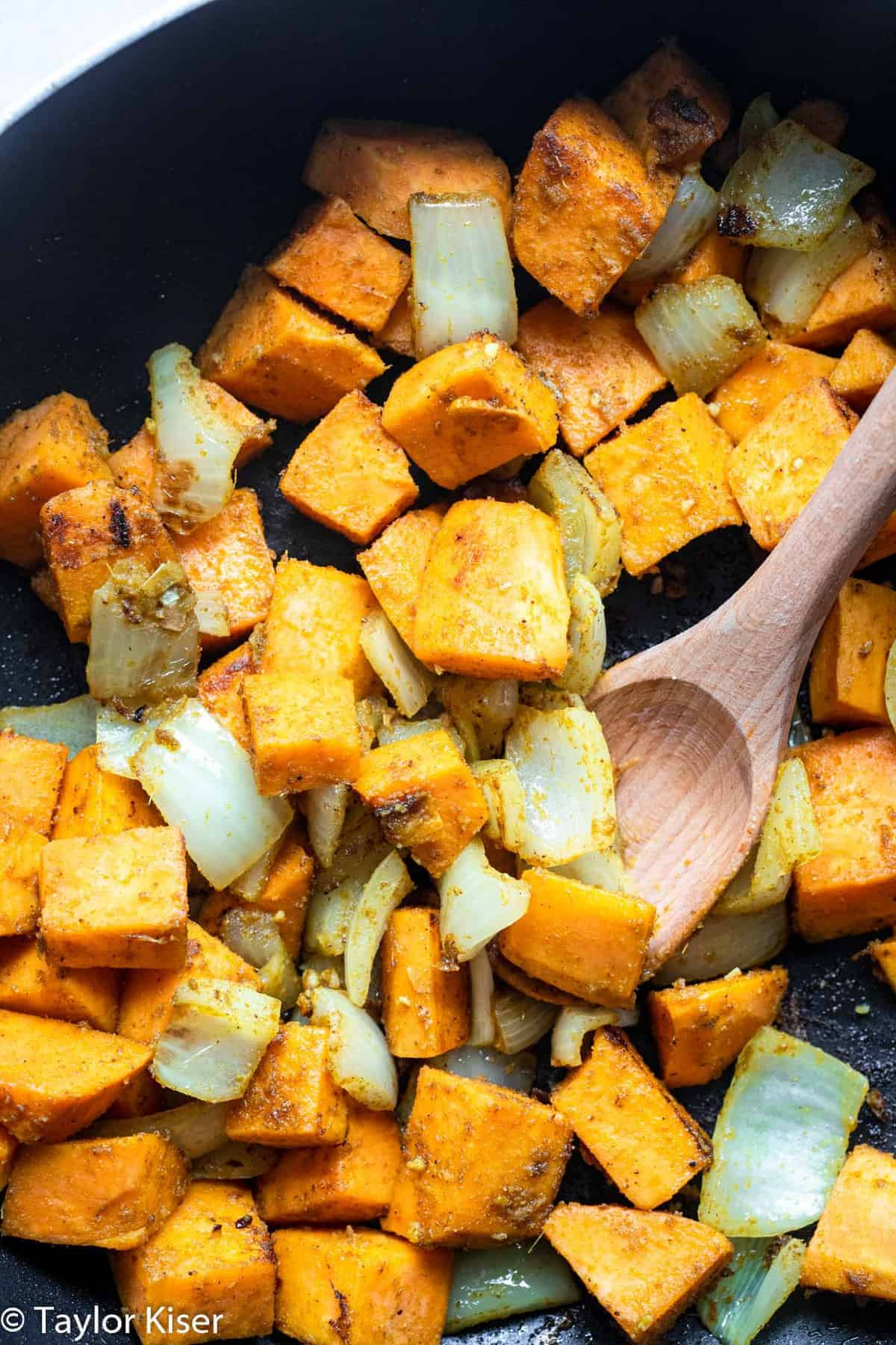 Sweet potatoes and onions in a cast iron pan