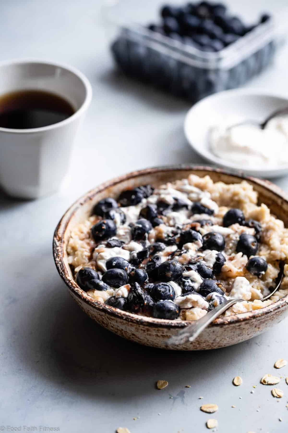 Blueberry Cheesecake Oatmeal - This quick and easy Blueberry Oatmeal with Cheesecake Swirl is a healthy, low fat and gluten free breakfast that tastes like waking up to cheesecake! | #Foodfaithfitness |