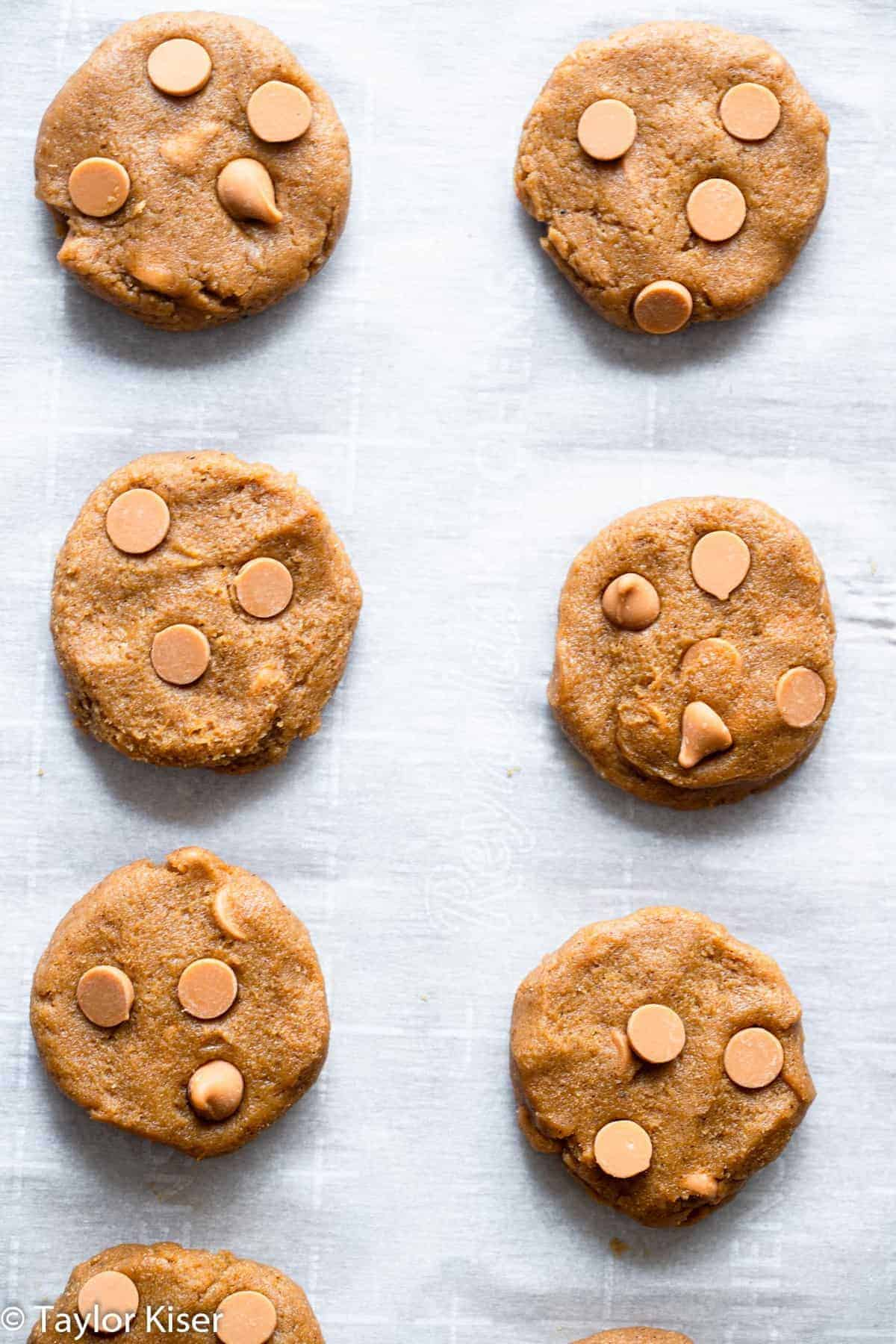 unbaked healthy pumpkin cookies on a baking sheet