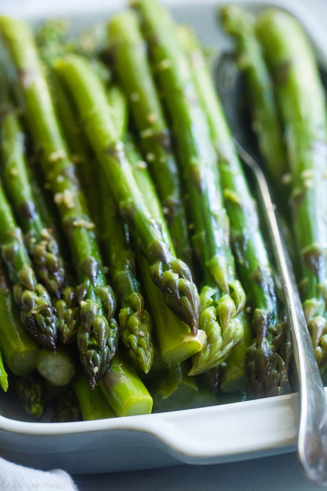 Close-up photograph of blanched asparagus. Recipe on foodfaithfitness.com
