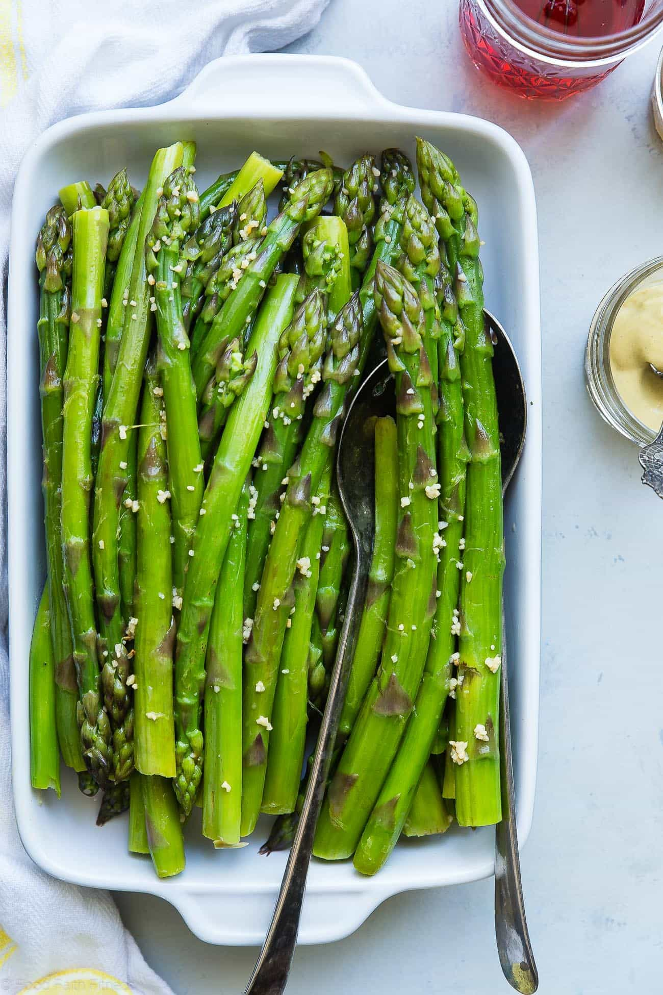 Overhead photograph of blanched asparagus. Recipe on foodfaithfitness.com